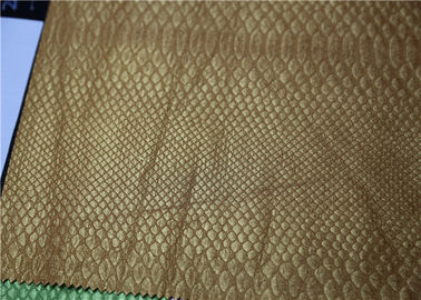 China Pearlied Gold Fake Leather Fabric Classic Snake Skin Pattern Fire - Retardant supplier
