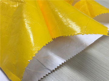 China 0.15mm Dupont Paper Coated Garment Leather Fabric Shining Yellow Color For Fashion Coat supplier