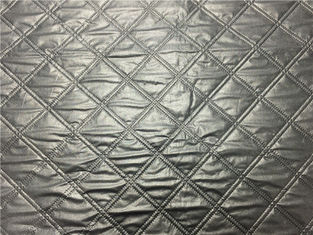 China Wadded Clothes 1.2mm Quilted Bonded Leather Fabric With Polyester Cotton Surface Silver Color supplier